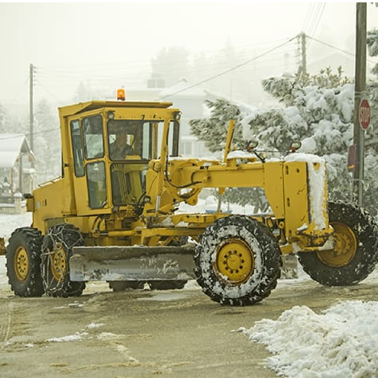grader or loader with tire chains