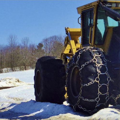 tractor using tire chains in the snow